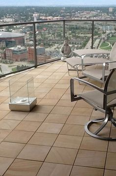 Roof deck paver tiles. This looks super easy to do, not permanent, and will protect the roof membrane.