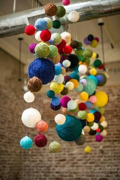Also easy! Just hang different color and size balls of yarn and hang them from a ceiling!