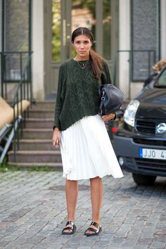 green cable knit sweater, white pleated skirt & slide sandals #style #fashion #streetstyle #stockholm