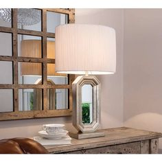 Contemporary table lamp with mirrored glass and resin base. This lamp also includes a stylish fabric shadeDimensions: x x Resin/Glass/FabricBulb Type: Table Lamps Uk, Table Lamps For Bedroom, Contemporary Table Lamps, Contemporary Interior Design, Wood Floor Stain Colors, Mirror Lamp, Mirrors, Large Lamps, Lamp Design