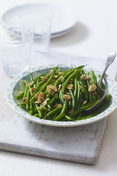 Lighten up a heavy holiday meal with this verdant side dish of green beans tossed in almond-garlic oil. If you want to kick up the flavor even more, add 1 Tbsp of vinegar at the very end, just before serving. Get the recipe.  - WomansDay.com