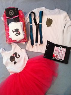 The invitation. Each girl received a pink tutu and singlet to wear to the party. The two boys received a shirt with a boy silhouette head and blue suspenders.