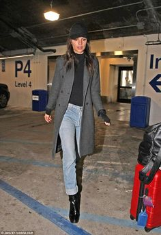 Soldiering on: If she was upset and stressed about someone allegedly leaking 200 private naked snaps, the 25-year-old was not showing it as she headed to her waiting car at LAX