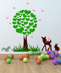 This darling decal set adds interest to a delightfully decorated bedroom or playroom. High-grade vinyl construction with a matte finish is modern and clean and the whimsical woodland scene is perfectly playful. All it takes is a squeegee and a pinch of patience to make it look like it was professionally applied. Tree: 27'' W x 45'' HDeer: 11'' W x 16'' H