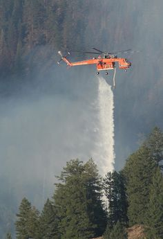 Helicopters firefighting in the North Fork Boise River area.