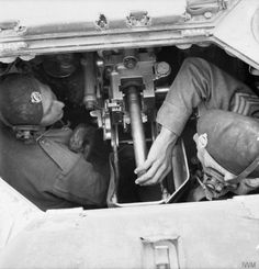 View inside the turret of a Valentine tank showing the 2-pdr gun being loaded, 27 March 1942.