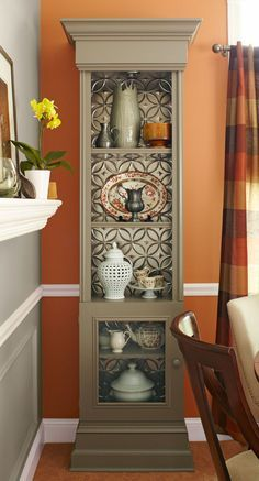 Pressed tin tiles on back of bookcase. Or entertainment center shelves? I could paint the tiles the same color as the accent wall adjacent to the entertainment center, that would give a pop of coordinating color AND texture. Repurposed Furniture, Painted Furniture, Diy Furniture, Refinished Furniture, Furniture Making, Tin Tiles, Tin Ceiling Tiles, Pressed Tin, Decoration