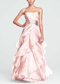 The perfect complement to a glamorous bride, this enchanting organza ball gown has it all!  Strapless empirebodice features ruched waist that flatters any figure.  Tiered organza A- Lineskirt is utterly romantic.  Ball gown silhouette is dramatic and slimming.  Fully lined. Back zip. Dry clean only.