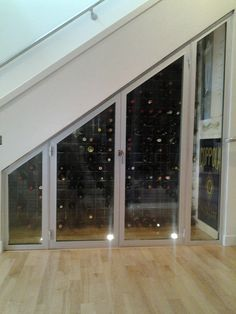 Great under the stair case wine cellar created with Mercer aluminum windows!