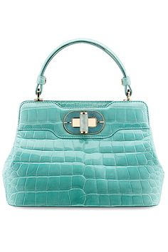 "Bulgari Isabella Rossellini bag in alligator. Leather is polished with agate stone and ""puffed up"" to produce the rounded, highly polished surface."