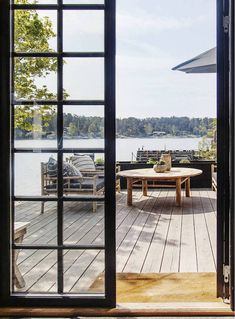 my scandinavian home: A Relaxed Swedish Island Summer Cabin on The Water's Edge Outdoor Dining Furniture, Outdoor Living, Outdoor Spaces, Summer Cabins, Cabin Interiors, Decks And Porches, Scandinavian Home, Cabins In The Woods, Coastal Homes
