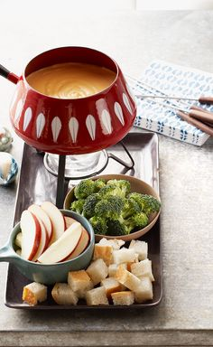 Quick Cheese Fondue — Shredded cheddar and VELVEETA team up with white wine and dry mustard to make this creamy fondue a glorious dip for bread and veggies.
