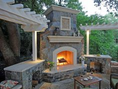 Traditional Patio with exterior tile floors, Milano side table, Trellis, Fire pit