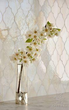 Does it get any prettier than a glass arabesque tile backplash? https://www.subwaytileoutlet.com/products/White-Arabesque-Glass-Tile.html#.VZr0oflViko