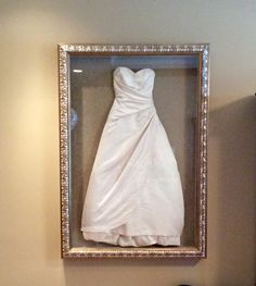 My wedding dress is too beautiful to store in a box never to be seen. I had it hand sewn into a shadow box and it's hanging in our bedroom. ❤️