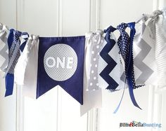 Navy and gray birthday banner for that little man in your life (or your more sophisticated man).  Chevron mixed with spots and stripes patterned fabrics. Use the bunting on a highchair, party table, feature wall or in a cake smash photo shoot.  We can create this banner to have ANY AGE you need. Please see the drop down menu.    This listing consists of :  • The banner measures 90cm /2.9ft in length, with 40cm (16 inches) of extra rope for hanging on either end.  • 1 x FABRIC flag (with ...