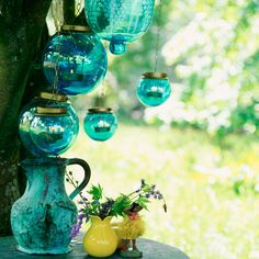 5 10 looks for outdoor lighting Glass lanterns 10 looks for outdoor lighting Candle Accessories, Garden Accessories, Porches, Garden Candles, Hanging Lanterns, Glass Lanterns, Green Lanterns, Shades Of Turquoise, Turquoise Glass