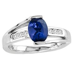 This glamorous ring consists of a magnificent oval tanzanite of almost 1.050 carats clutched at the top and bottom from white gold. A channel of 6 round diamonds of 0.130 carats is etched on the band made of 14k white gold. The bluish violet radiance of the tanzanite looks more stunning when it is paired up with gorgeous evening attire. This ring looks extremely stylish and could be the first choice to the females who like to stay in vogue.