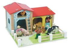 Le Barnyard  A beautifully painted wooden farm from Le Toy Van featuring a storage barn, cow shed and stable. Le Barnyard sits on a detailed baseboard and comes with moveable fences. The side panels screw down onto the baseboard however the roof panels slot in so are removable for more interactive play