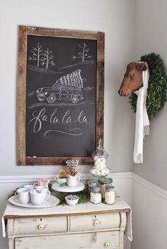 Chalkboard, wreath, faux animal head, hot chocolate bar.