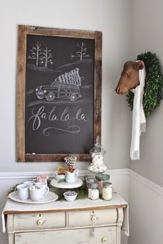 Chalkboard, wreath, faux animal head, hot chocolate bar.