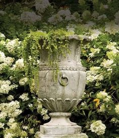 Shop Frontgate's collection of outdoor planters and garden urns to dress up your garden, terrace or entryway. These planters and terrariums make the perfect patio decor. Urn Planters, Outdoor Planters, Outdoor Gardens, Recycled Planters, Stone Planters, Cement Planters, Planter Ideas, Wheelbarrow Planter, Outdoor Garden Statues