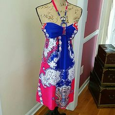 STUNNING STRAPLESS SUNDRESS Get ready for the summer festivities. The rich colors of royal blue and a reddish coral color with paisley designs all over. The strap around the neck doubles as a strap and necklace. Oh so lovely! Dresses Strapless