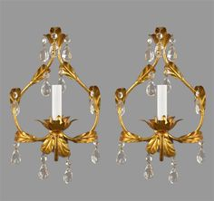 "Offered here is a unique pair of gilded tole and Italian quality almond crystals, made around the 1950's.  These pieces have been wired, cleaned and restored by our restoration staff.  Each sconce measures 14"" tall by 9"" wide by 6"" deep.  Each sconce has one socket accepting one 60 watt candelabra based bulb."