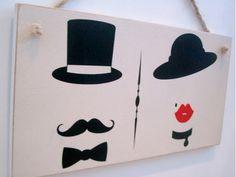 Toilet door sign with vintage ladies and gentlemen icons.