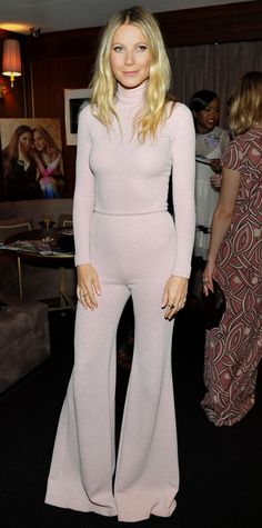 Gwyneth Paltrow created the illusion of a jumpsuit at The Hollywood Reporter's Power Stylists Dinner in a pale pink turtleneck honeycomb Emilia Wickstead bodysuit that she styled with a pair of matching high-waist flares.