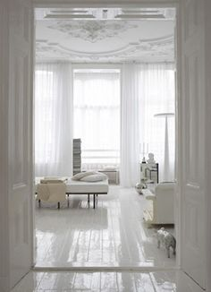 white glossy painted wood floors