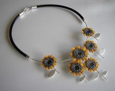 Flower necklace by Jolanta Bromke. Leather necklace, sunflowers. Light necklace made of 925 silver and leather. Invoiced skin, hand painted, decorated with flowers sunflowers oxidized, silver beads. Silver brushed, polished lipping. The whole hung on a leather thong. Circumference of the necklace 46 cm.
