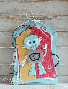 Handmade tag by DT member Wybrich with Craftables Punch Die Nuts & Bolts (CR1324), Labels Basic Shape (CR1352), Label XL & Label XS (CR1353) and Collectables Robot (COL1403) from Marianne Design