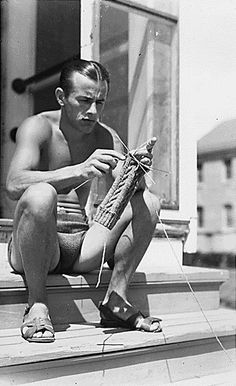 I have no idea who this is but he is cute and he is knitting.
