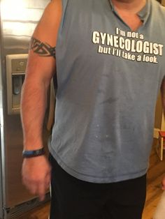 Dude wearing offensive shirt saying I am not a Gynecologist, but I can take a look.