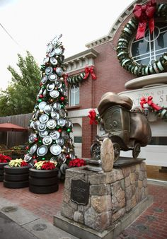 Hubcap Christmas Tree at Radiator Springs, Cars Land decorates for the holiday