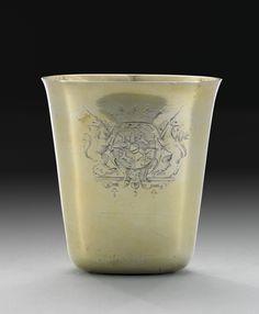 Gilded silver cup from 1707 (engraved in 1719), Swedish: BÄGARE, av Petter Henning, Stockholm 1707, oval, förgylld, på livet graverat vapen för greve Axel Banér, höjd 11,8 cm, mynningen 11x7,5 cm, graverad. Viktangivelse 30 7/8 lo (lod), vikt 286 g.  HISTORIK: Petter Henning, verksam i Stockholm 1688-1713 var hovguldsmed hos Karl XI, Karl XII och Hedvig Eleonora. Axel Banér blev greve 1719 då sannolikt vapnet graverades.