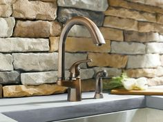 Moen Rubbed Bronze One-Handle High Arc Pullout Kitchen Faucet