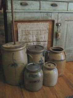Old Crocks & Butter Churn.by an old prim cupboard. Antique Crocks, Old Crocks, Antique Stoneware, Stoneware Crocks, Primitive Kitchen, Primitive Antiques, Primitive Decor, Primitive Country, Prim Decor