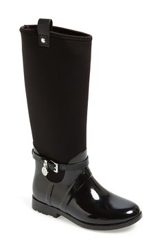 Michael Kors takes rain boots to a new level with this stylish black boot complete with a sleek belt.