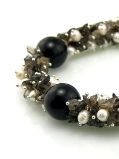 Cluster Beaded Bracelet Black and White.  Freshwater pearls are combined with smoky quartz chips to create this textured bracelet. By TrinketsNWhatnots, $25.00  www.trinketsnwhatnots.etsy.com