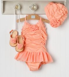 OMG! Baby beachwear!  Adorable!! Our Emma Bug would look so cite in this!!! love the ruffle buns that I got her!!! <3