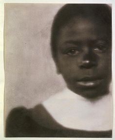 F. Holland Day:    Girl in dress with white collar, 1905  Copyprint of gum bichromate print