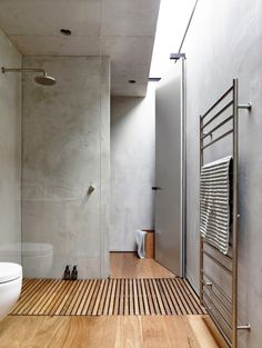 Skylight. Bamboo floors. Concrete walls. Brass tapware. Perfection.