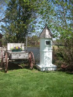 A Little Garden Art Structure that holds a 55 gallon drum to hold water.  I can connect my hose to the back and water areas that my hose won't go.  Beautiful Copper Roof that got repurposed.