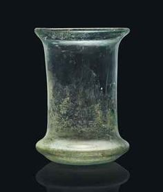 A ROMAN PALE GREEN GLASS BEAKER CIRCA 2ND-3RD CENTURY A.D. 4.1/8 in. (10.5 cm.) high