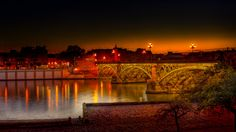 The Isabelle II Bridge - A night view of this famous bridge in Seville, Spain
