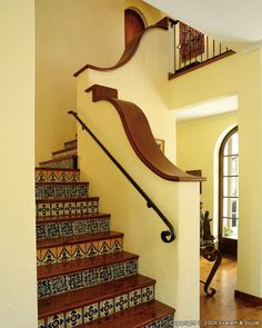 Interesting solution if the house you buy happens to have a solid style staircase and the tear-down and addition of a full-on wrought-iron design would be cost prohibitive. Not that this looks inexpensive, mind you...but it could serve  as an alternative.