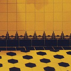Vintage Look Bathroom Tile: Walls and floors were clad in ceramic squares and octagons in shades of yellow, green, blue, even pink. A black or patterned border tile often topped wainscoting and stood in for baseboards.