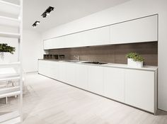 mk 022  Matt white glass 12 mm thick and smoke finish oak 12 mm thick worktop, matt white glass doors with matt white frame,backs panel and boxes in smoke oak, graphite structures, stainless steel electrical opening drawers, white matt lacquer profiles and plinth.
